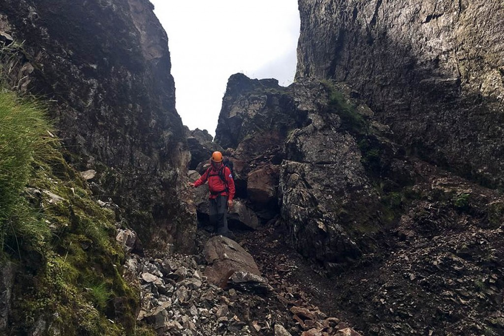 A Wasdale team member at the site in Lord's Rake where the large boulder has fragmented. Photo: Wasdale MRT