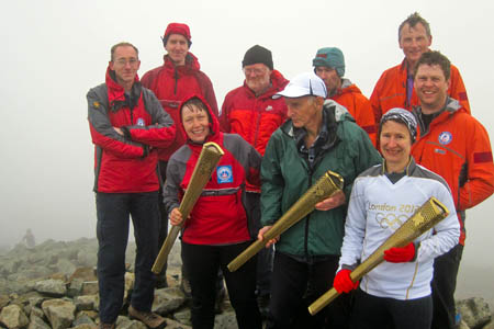 Karen Green, Joss Naylor and Angela Brand-Barker are joined on the summit by Wasdale MRT members Dave Kennedy, Ian Winn, Nick West, Paul Cook, Rob Scott and Chris Cripps