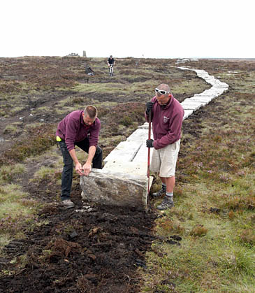 Laying a path across the South Pennine moors as part of the project