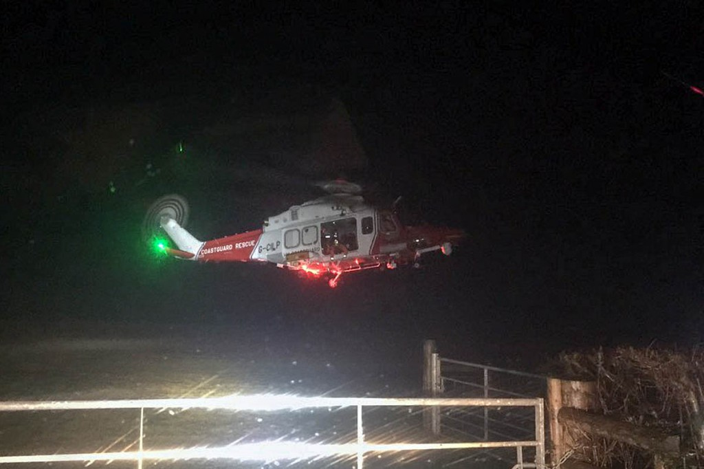 The Coastguard helicopter in action during the rescue. Photo: Western Beacons Mountain Search and Rescue Team