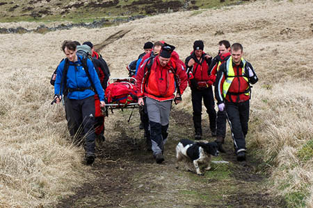 Team members will carry the stretcher across the Brecon Beacons. Photo: Western Beacons MSRT