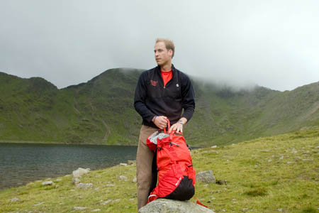 Prince William, in Patterdale MRT uniform, at Red Tarn, with Helvellyn in the background