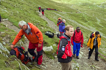 Prince William on his way up Helvellyn with Seyi Obakin, second from right, and Richard Warren, left, chair of the Lake District Search and Mountain Rescue Association