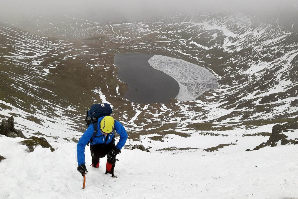 Bob Smith wheezes up Swirral Edge during the course. Photo: Zac Poulton/Lake District NPA