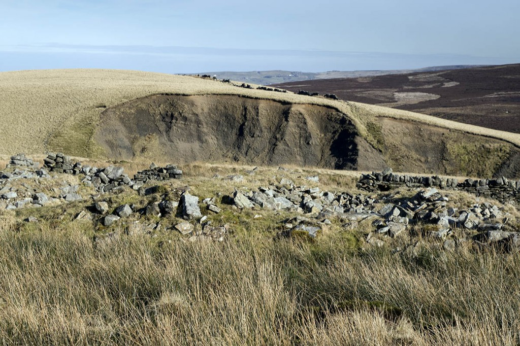 The ruins of Lower Withins with Scar Hill in the distance