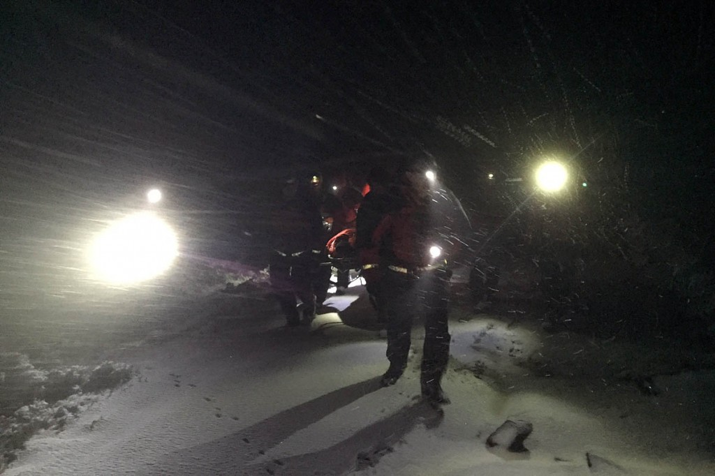 Team members stretcher the hypothermic walker from the moors. Photo: Woodhead MRT