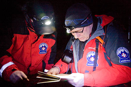 Rescue team members plan their search