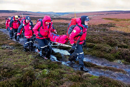 The runner is stretchered to safety. Photo: Adrian Ashworth Photography