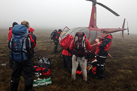 Rescuers at the landing site above Woodhead Pass. Photo: Woodhead MRT